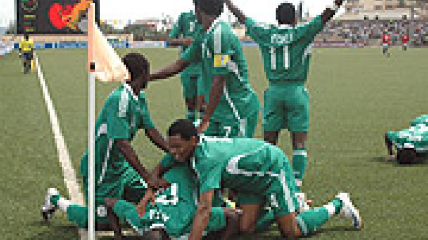 SO HELP ME GOD: Nigeria's players celebrate their second goal against Egypt in the group stage. The Flying Eagles are on course for an unprecedented sixth African youth  title but first they must beat Cameroon in the semifinal this afternoon. (Photo / G.