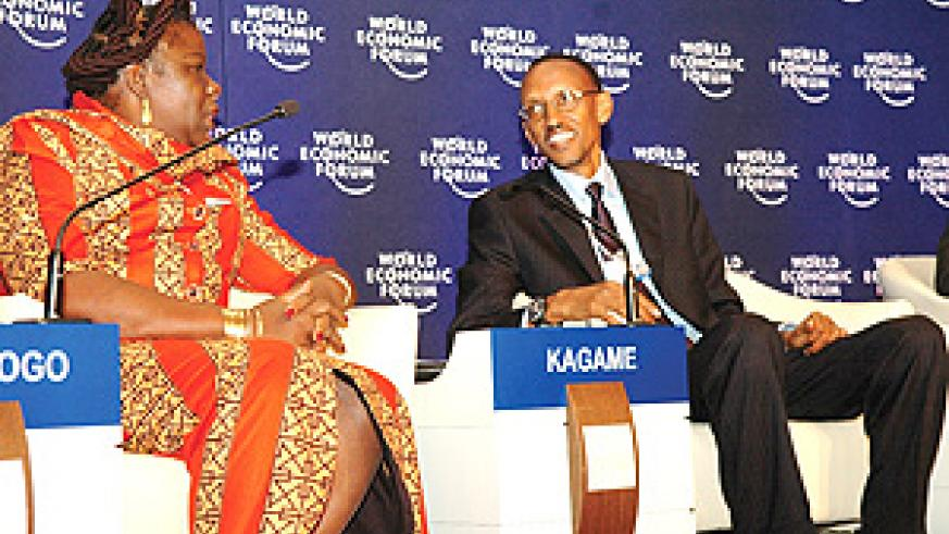 President Kagame shares a light moment with the Prime Minister of Mozambique, Luisa Dias Diogo, during the World Economic Conference in Davos, Switzerland yesterday. (Photo PPU).