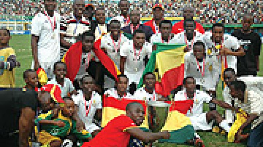 Ghana players and officials celebrate their third African Youth Championship after defeating rivals Cameroon 2-0 at Amahoro stadium yesterday. (Photo / G. Barya)