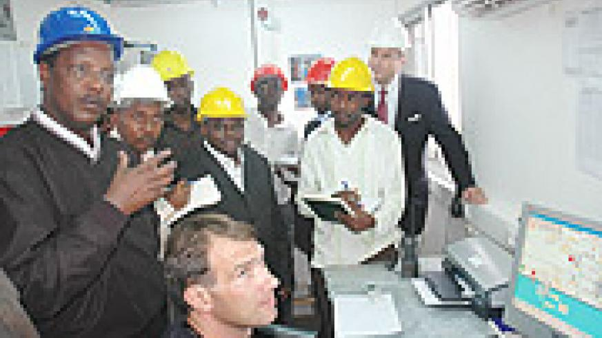 State Minister for Energy Albert Butare (L) in the Methane Gas Plant that generates Electricity late last year. (File Photo).