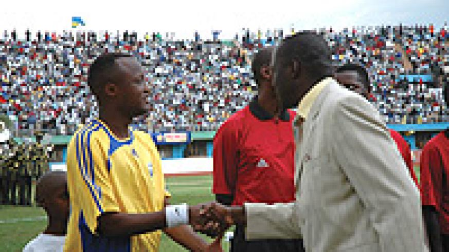 Jimmy Gatete greeted by sports minister Joseph Habineza before a Rwanda vs Cameroon game in 2006 ACN qualifiers.