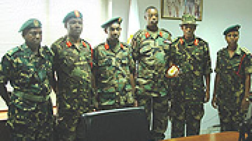 The CDS Gen. Kabarebe (3rd left) and Director of Operations, Tanzanian military Brig Genl Fa Muhammad ( 2nd right). (Photo/G. Barya).