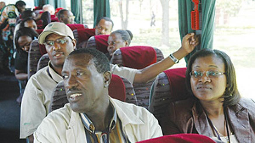 Senior government officials aboard a bus as they left for the Sixth National Leadership Retreat at Kivu Serena Hotel in Rubavu yesterday. (Photo PPU)