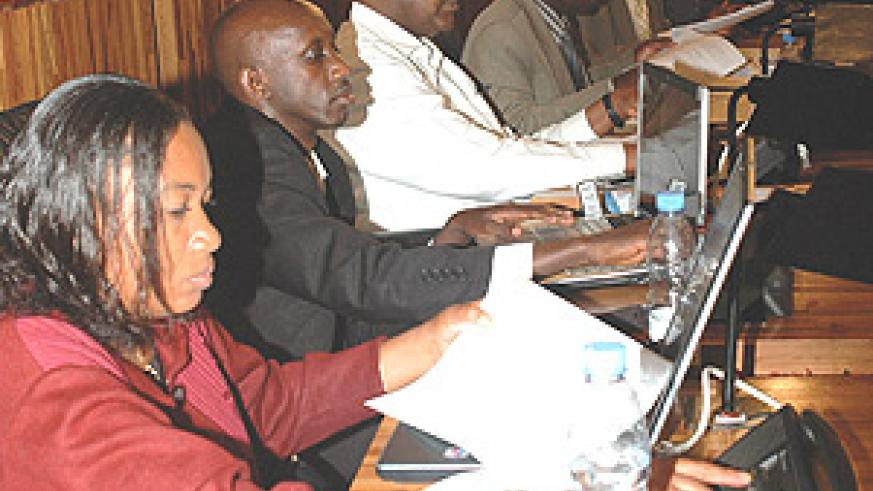 MPs Marie Claire Ingabire and Francis Kaboneka and other members of the lower chamber voting for the media law yesterday at the parliamentary building in Kimihurura. (Photo/ G.Barya).