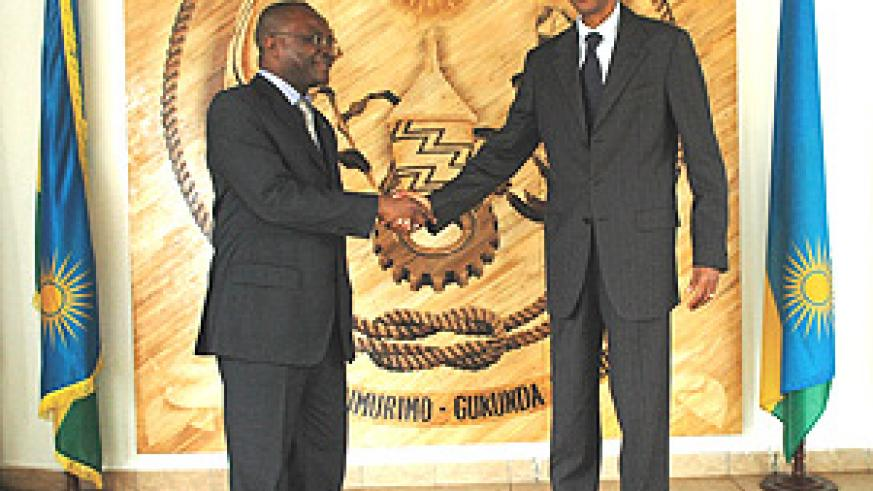 President Kagame with Aurelien  Agbenonci, UN Resident Coordinator briefly after their meeting yesterday. (PPU Photo).