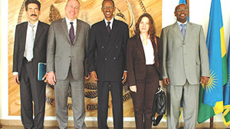 President Kagame with the IMF team led by Mark Plant,Dimitry Gershenson (L) and Murgasova. Also present was the Minister of Finance, James MUSONI.