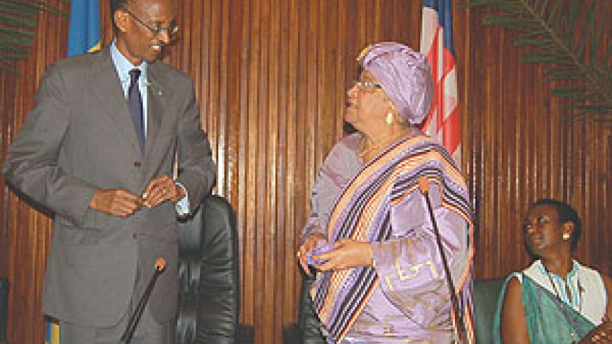 President Kagame is congratulated by President Johnson Sirleaf after receiving Liberia's highest state honour. (PPU Photo)