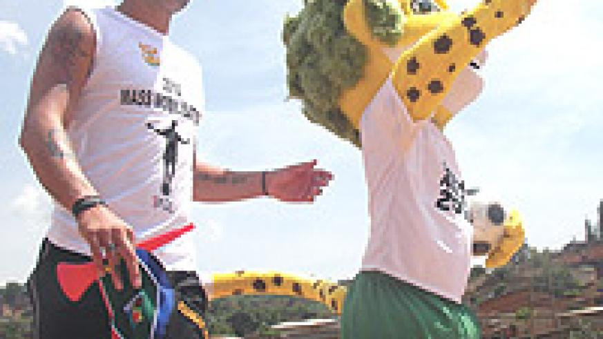 MOBILISATION: Ex-South African players Mark Fish unveils the 2010 World Cup Official Mascot Zakumi yesterday in Kimisagara, Kigali.