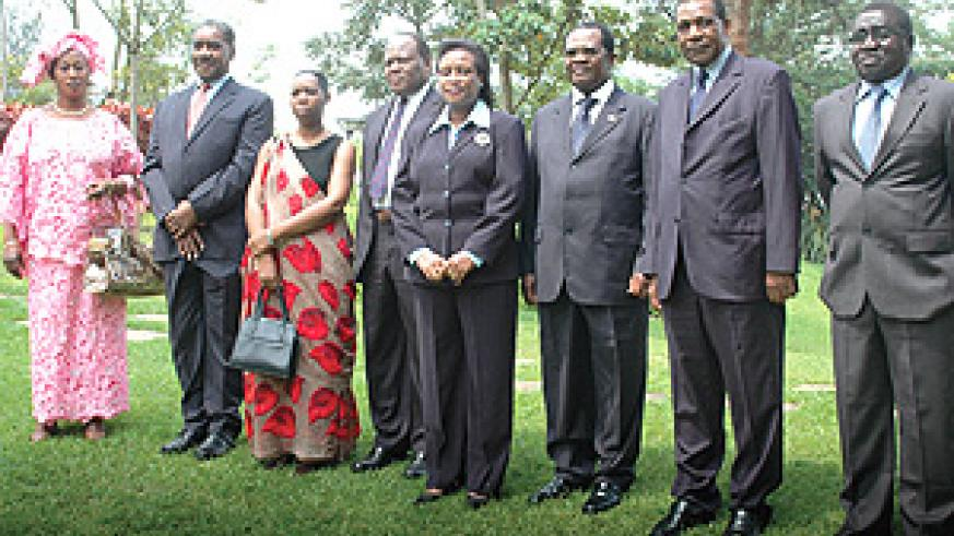 EAC Chief Justices and Beatrice Kiraso (Fifth from left), the bloc's Deputy Secretary General, in a group photo after the opening of the meeting yesterday. (Photo/ G. Barya).