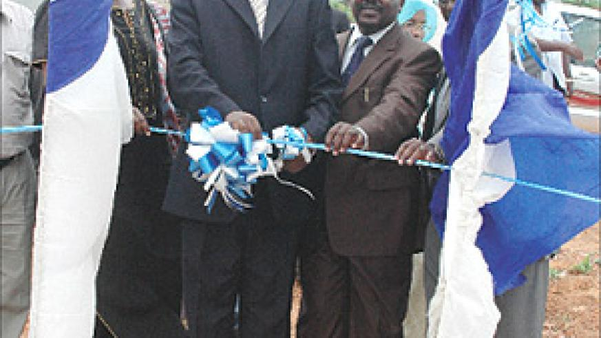 Finance Minister James Musoni cuts the ribbon to mark the launch of the sale of new plots in the Central Business District yesterday. (Photo GBarya).