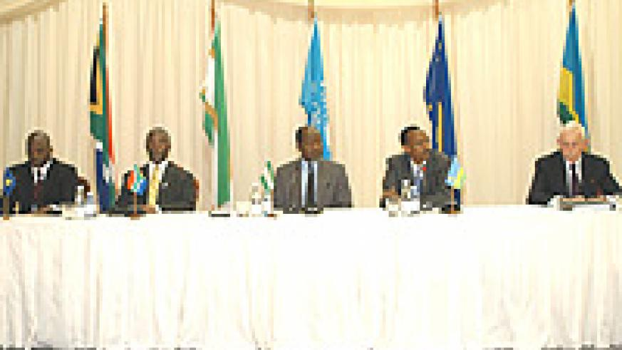 L to R: H.E. Joseph Kabila (DRC), H.E. Thabo Mbeki (RSA), H.E. Joachim Chissano (Mozambique), H.E. Paul Kagame, (Rwanda), and Amb. William Swing (UN Representative) attending the Third Party Verification Mechanism summit on 27th November 2003 in Pretoria.