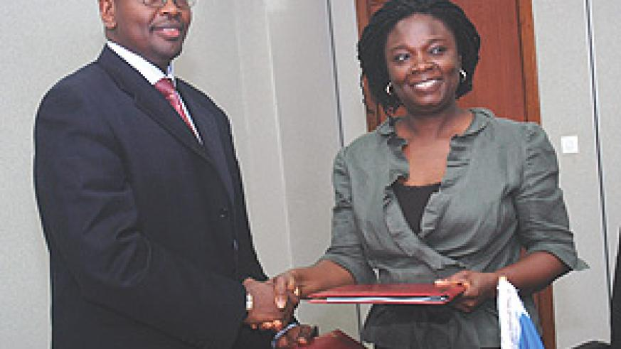 Finance Minister James Musoni and World Bank country  representative Victoria Kwakwa.(Photo/ G. Barya).