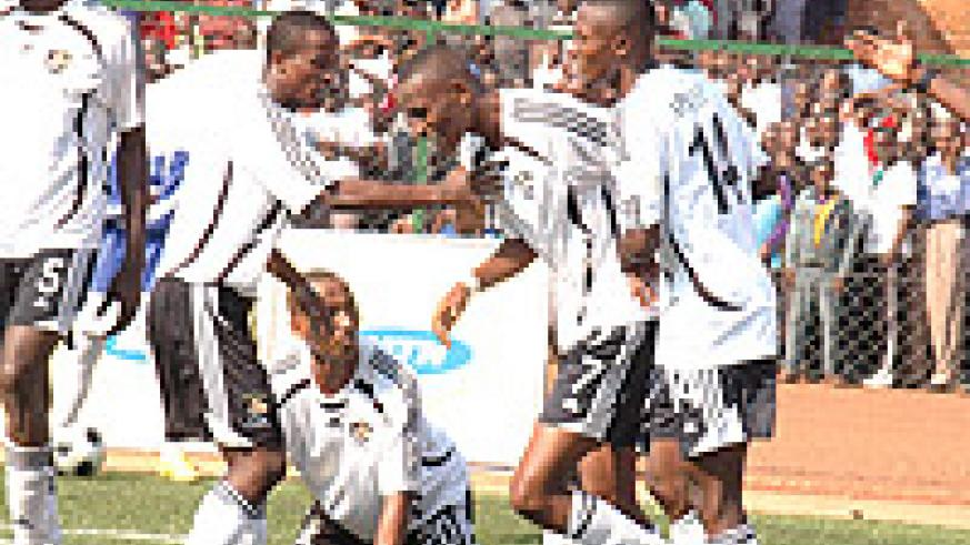 APR players celebrate after scoring in last year's Amahoro Cup final. They are one of 32 teams drawn this year. (File Photo).