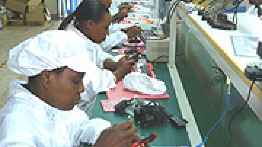 Women assembling mobile phones at the A-Link Technologies premises in Kacyiru. They will assemble laptops in the company brand A-Link soon this year.