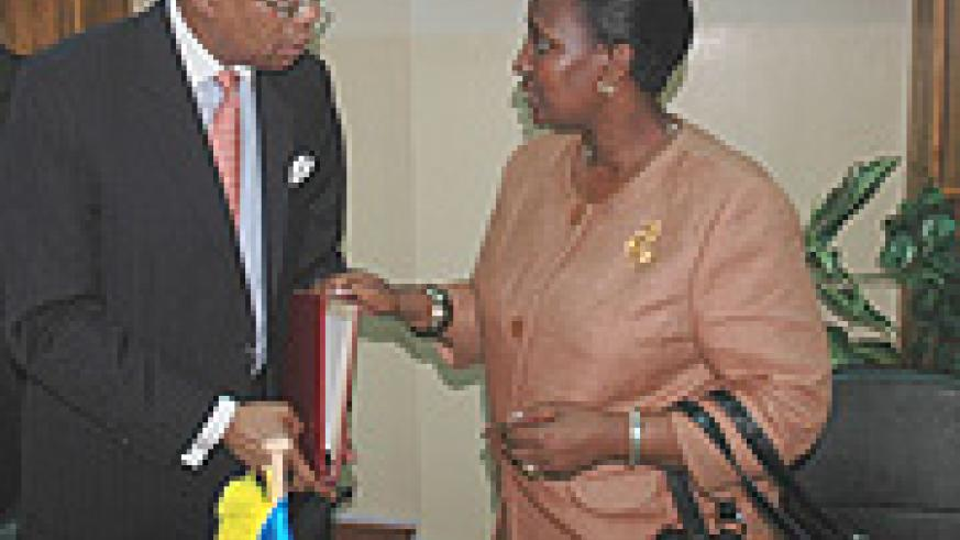 Foreign Affairs Minister Rosemary Museminali (R) talks to Amb. Carlton A. Masters. (File photo).