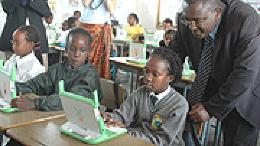 State Minister for Primary and Secondary Education Theoneste Mutsindashyaka inspects  Pupils using laptops At Green Hills Academy yesterday. (Photo/ G. Barya).