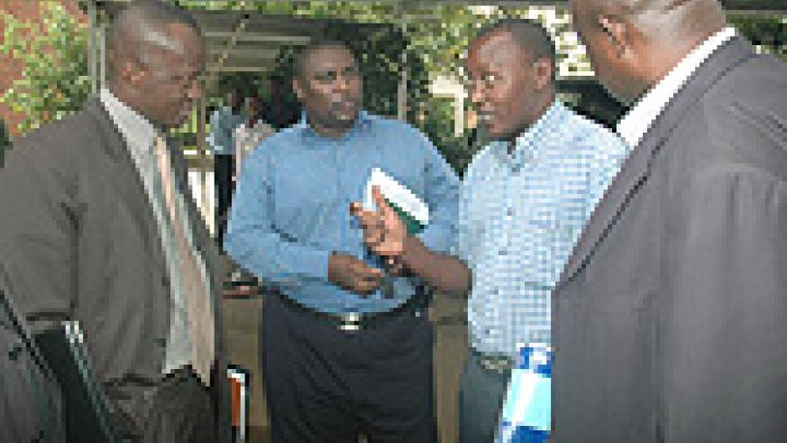 Culture and Sports Minister  Joseph Habineza (L) listens to journalists after the press conference at the Prime Minister's Offices yesterday. (Photo/ J . Mbanda).