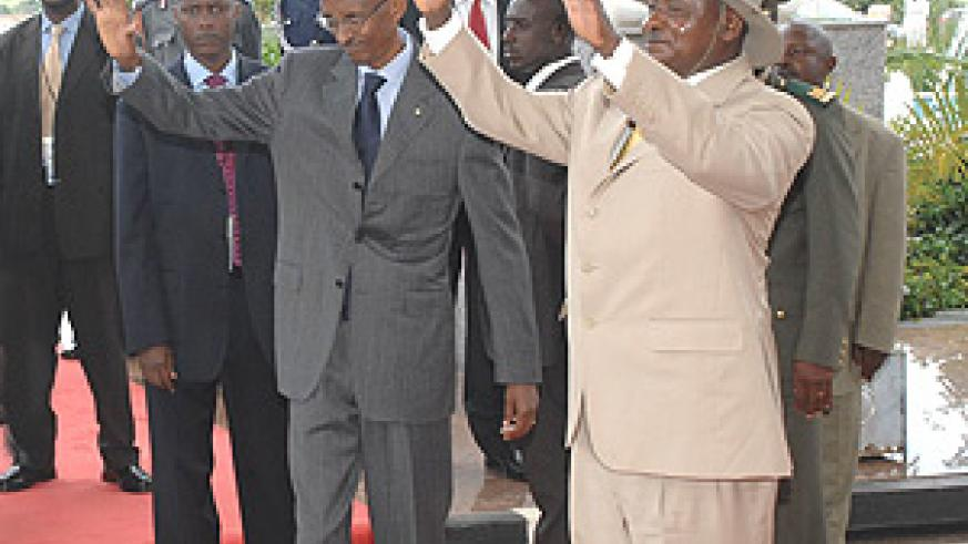President Paul Kagame and his Ugandan counterpart, Yoweri Museveni , at Entebbe in Uganda. (Courtesy Photo).