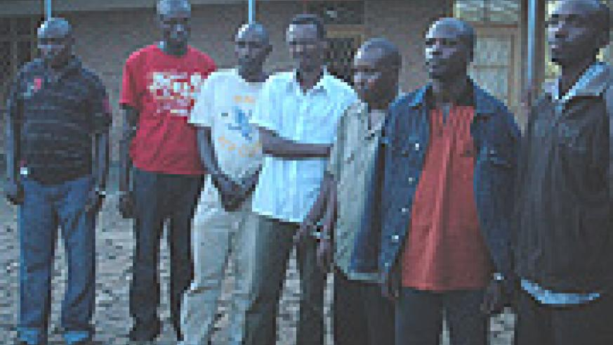 Alleged ringleader of the raid, Jean Claude Ntirenganya (second left) with his accomplices at Remera police station yesterday. (Photo/ G. Barya).