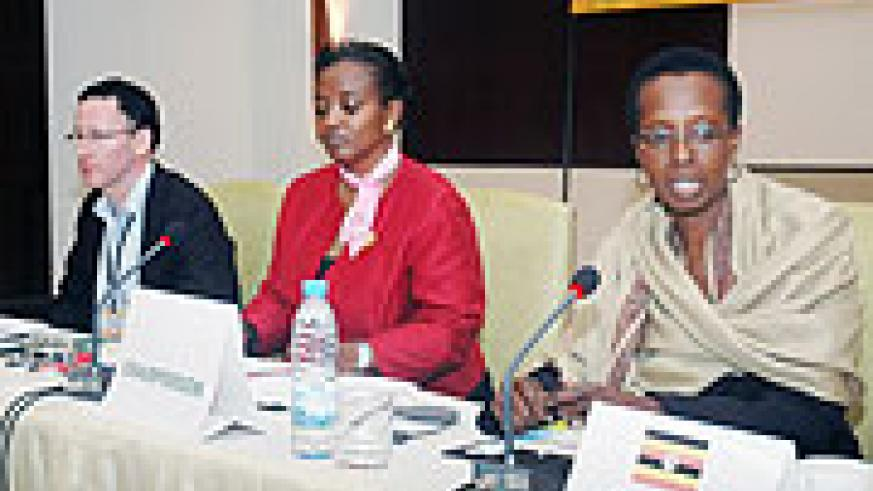 Uganda Revenue Authority chief Allen Kagina (R) and her Rwandan counterpart Mary Baine with Richard Stern at the closure of the International Tax Dialogue. (Photo J Mbanda).