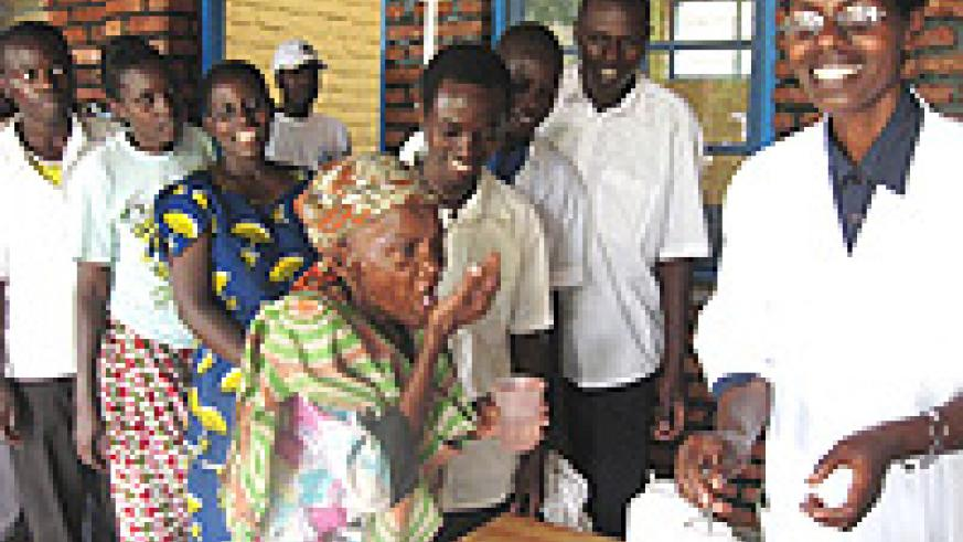 During an adult de-worming exercise carried out last year in Gacumbi villages and around Lake Muhazi.