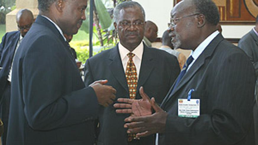 Minister of Defence General Marcel Gatsinzi (C) chatting with Prof. Tarsis Bazana Kabwegyere (R), Uganda's Minister of Relief, Disaster Preparedness and Refugees and Charles Murigande (L) at the workshop yesterday. (Photo/ G.Barya).