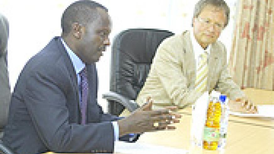 Prosecutor General Martin Ngoga  and Erhard Rex from Germany  briefing the press after their meeting at the former's offices yesteday.(Photo/ G. Barya).