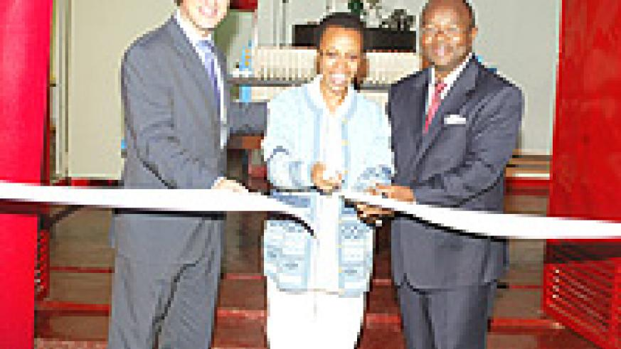 (L-R) BRALIRWA's Managing Director, Sven Pieteriet; Director General (REMA), Dr Rose Mukankomeje; Coca-Cola East and Central Africa Manager Prosper Tchovambe cutting the ribbon to officiate the wastewater treatement plant on Wednesday.
