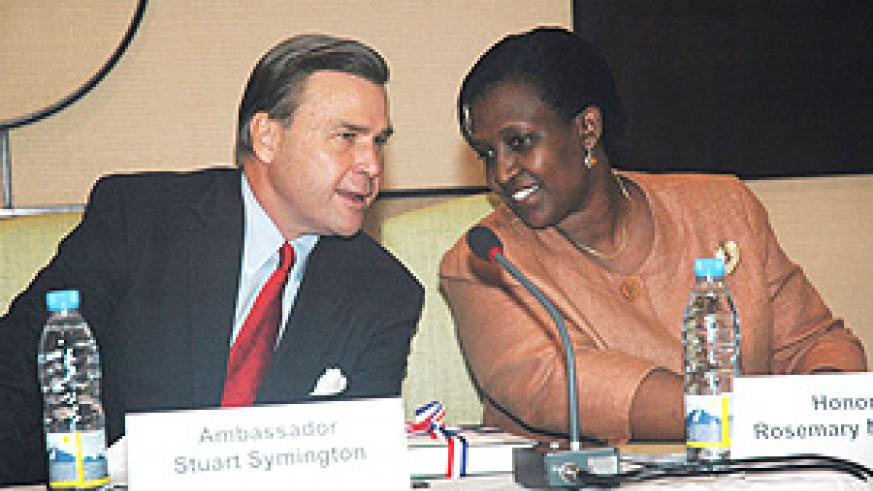 US Ambassador Stuart Symington (L) talks to  Minister Rosemary Museminali during the seminar on managing security resources in Africa at Serena Hotel. (Photo J. Mbanda).