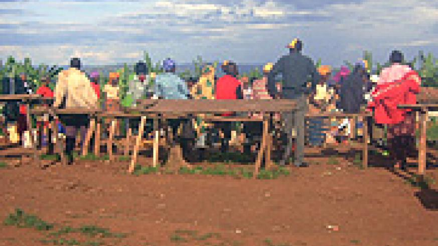 Residents wait for the market to start operations after sunset.
