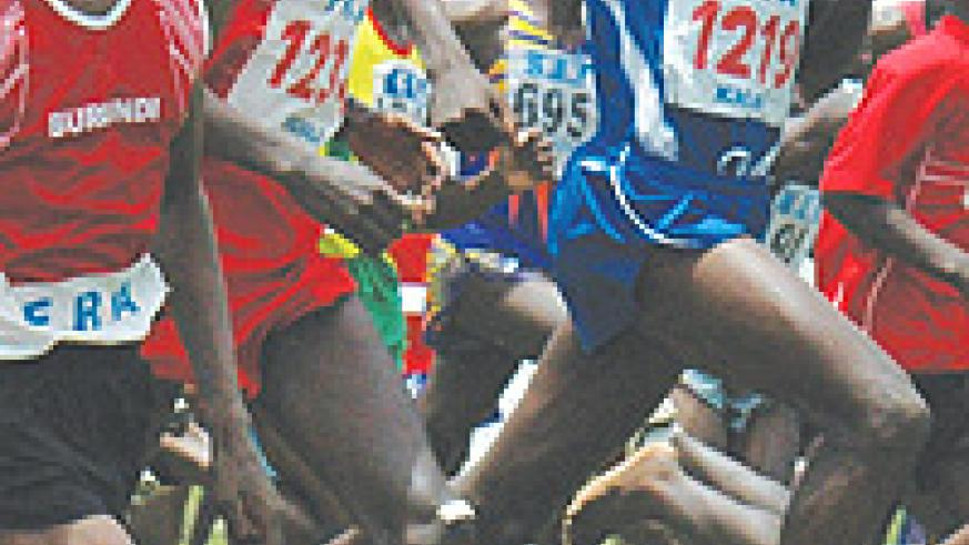 Dieudonne Disi (M) and Rukundo (R) will fly Rwanda's flag in the Kigali international meet. (File photo)