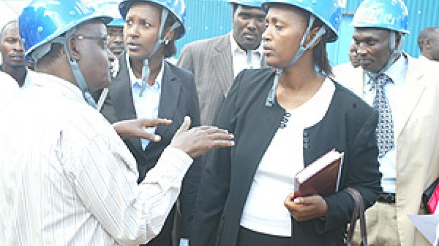 RAMA Director General Dr Innocent Gakwaya (L), Infrastructure Minister Linda Bihire (C) and Vice Mayor Jeanne d'Arc Gakuba touring the RAMA House under construction. This was after the launch of the building regulation manual. (Photo GBarya).