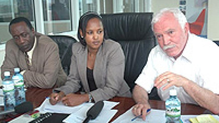 George Mulamula (left) during a recent RDB press briefing. On the right is Joe Ritchie the RDB CEO (File Photo)