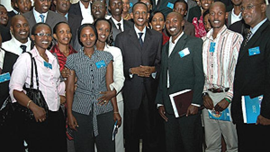 President Kagame poses for a group photo with the 'President's 100' after their interactive session at Prime Holdings yesterday. (PPU Photo).