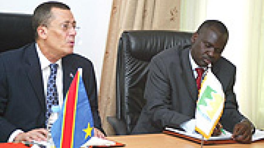 DR Congo Minister of Water Jose Endundu and his Rwandan counterpart Stanislas Kamanzi during the former's recent visit to Rwanda. (File Photo).