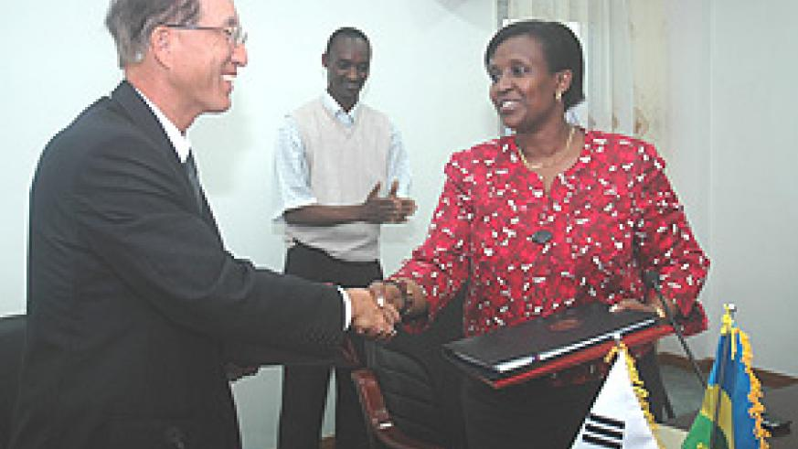Korean Ambassador to Rwanda Kim Young-Jun (L) shaking hands with Foreign Affairs Minister Rosemary Museminali after signing the agreement. (Photo J Mbanda).