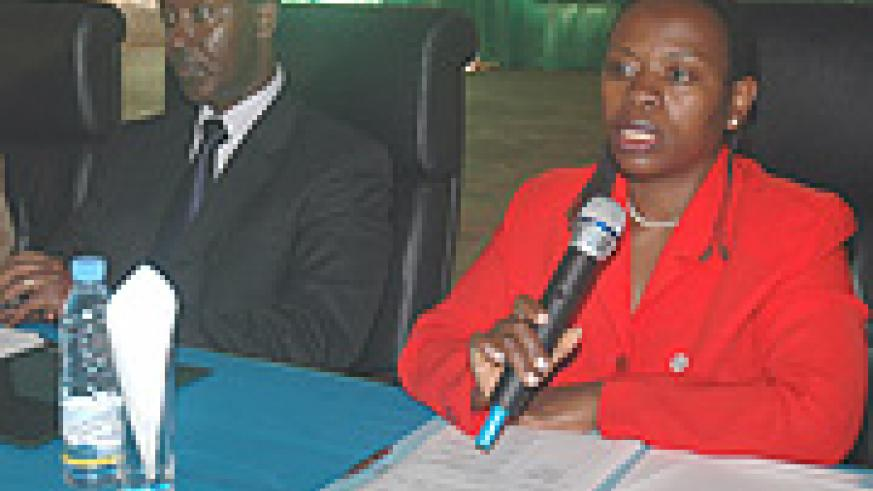 Commerce and Industry Minister Monique Nsanzabaganwa (R) speaking during the Public accountability day. With her are PS Antoine  Ruvebana  (Photo J Mbanda)