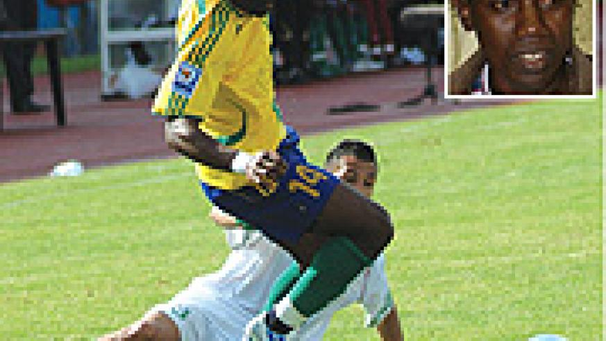 Saidi Abedi tries to protect the ball during Amavubi's goalless 2010 World Cup/CAN qualifier against Algeria. (Inset is Jean Baptiste Kayiranga)