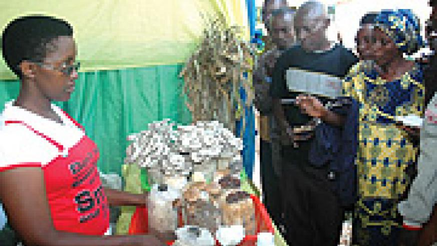 Rural farmers visiting the on going Agricultural expo at Mulindi in Gasabo District, inquire about how Mashrooms grown. (Photo J Mbanda)