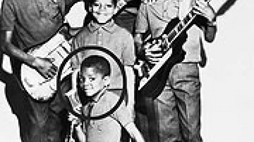 The 5 Jacksons pose for a group photo with their music instruments