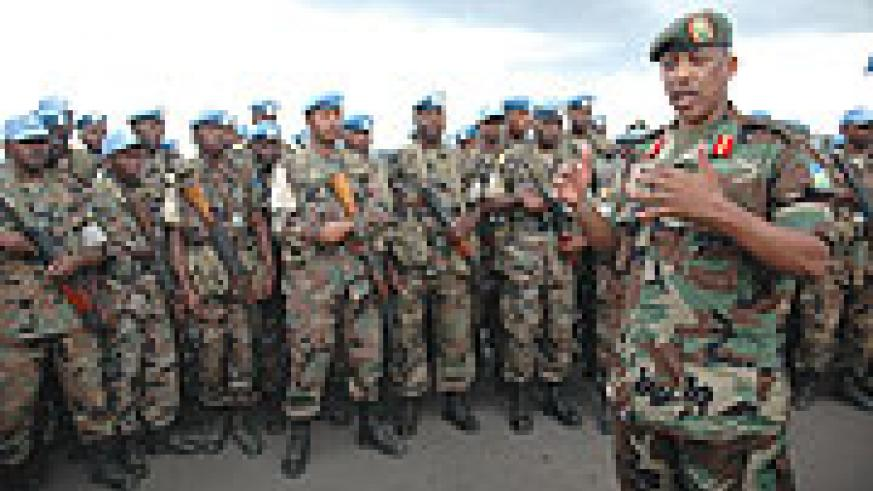 Gen. Nyamvumba addressesing troops who had just returned from the peace keeping mission in Darfur (file photo)