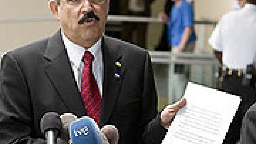 Ousted Honduras President Manuel Zelaya holds a diplomatic note from the U.S. State Department after meeting with U.S. Secretary of State Hillary Clinton in Washington on July 7