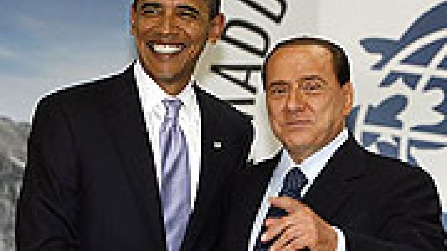 U.S. President Barack Obama is greeted by Italian Prime Minister Silvio Berlusconi before a working lunch session of G-8 leaders at the summit in L'Aquila, Italy
