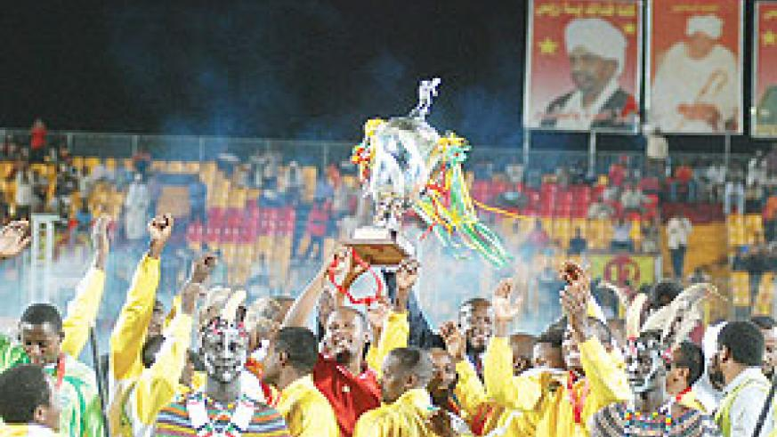 Sports Minister Joseph Habineza leads Atraco players in celebrating yesterday's CecafaKagame Cup Final win. Atraco beat Sudanese giants El Merreikh 1-0 to win the trophy for the first time. (Martha/ Ayuro)
