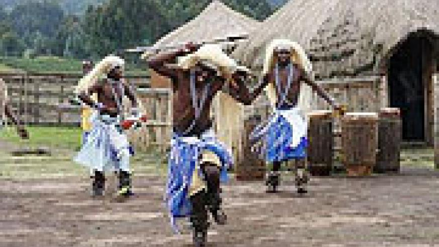 Warriors do a traditional dance, called an Intore, at the Iby'wacu Cultural Village. Many used to be involved in the illegal animal trade, but learned ancient arts that they share with visitors and Rwandans alike.(Photo by DAN ROBSTON)