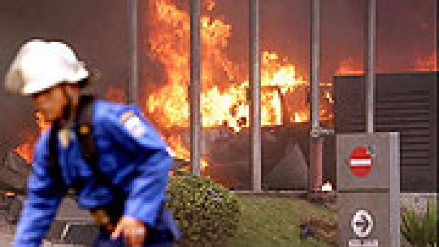 Fire personel attempting to put of the fires caused by the suicide bomb attack on JW Marriott and Ritz-Carlton hotel, Jakarta, Indonesia
