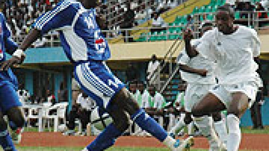 APR's Mbuyu Twite fights for the ball with a Maranatha player. APR were yesterday knocked out of the MTN Peace Cup. (File photo)