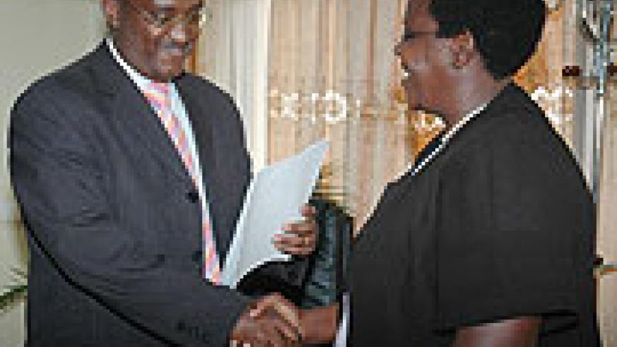 Former State Minister for Primary and Secondary Education Theonest Mutsindashyaka handing over to Education Minister Daphrose Gahakwa on Friday. They are now both out.