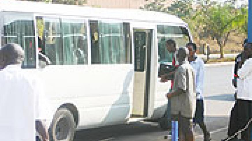 Passengers entering a city center bound bus. The price changes have confused many.