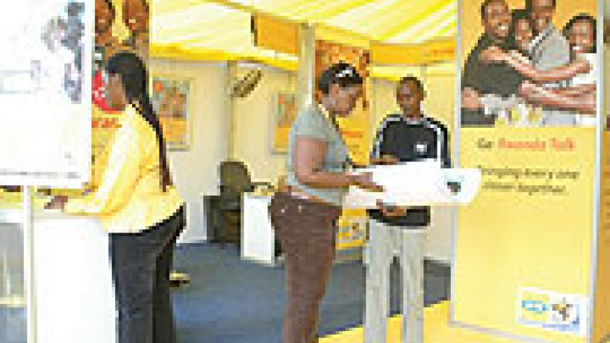 MTN Rwanda employees at an MTN stand during a recent exposation (File Photo)